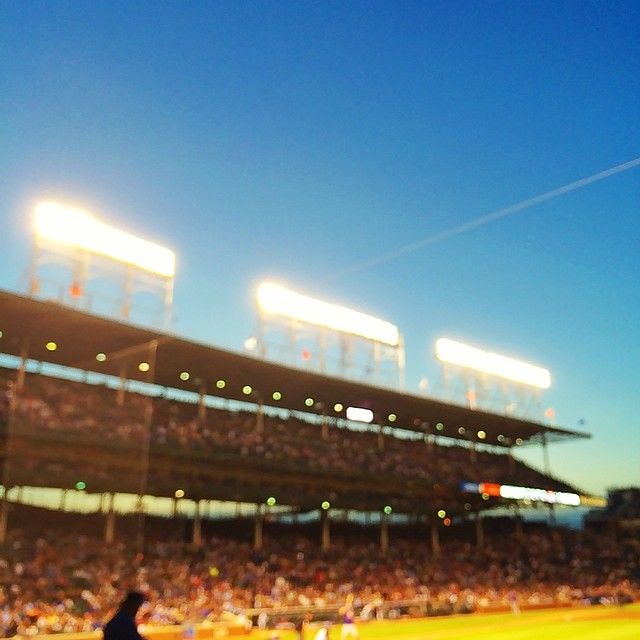 Lights are up. Beautiful #chicago night. #cubs are hanging tough against the #mets. Magical #wrigley #field