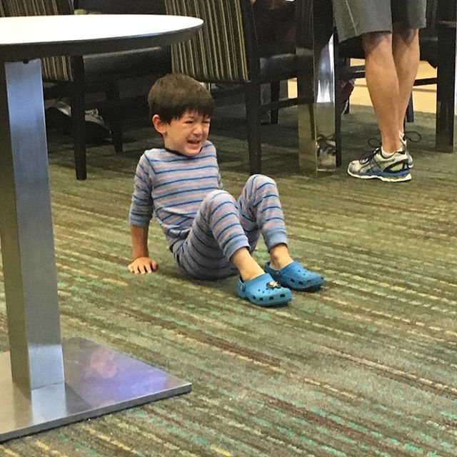 Random young boy throwing a fit and refusing to get off the floor at breakfast in #chicago hotel.