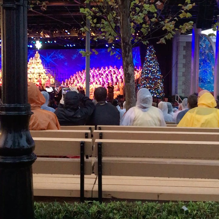 Edan sings at #disneyworld in the Candlelight Procession with @stevencurtischapman. Beautiful sunset with rainbow.