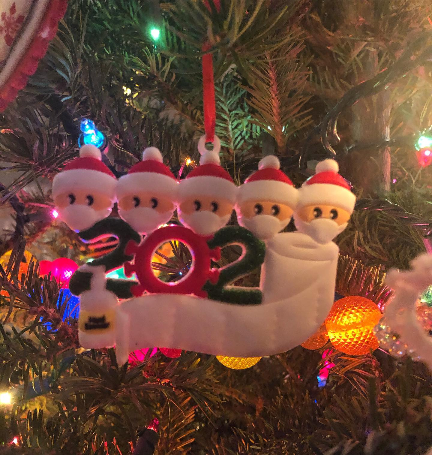 This years Christmas ornament: the second 0 in 2020 is toilet paper, the first 0 is a virus and there is a mini hand sanitizer and all the little faces are wearing masks