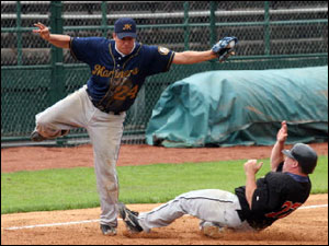 Matt Dumont of the Boston Mariners tries for tag