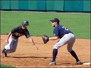Alan Donaruma dives back to first base
