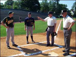 Skippers Kevin McGowan and Matt Englander take ground rules at Doubleday Field