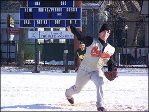 US Army's Kevin Bell pitches through the snow