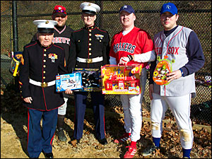 Toys for Tots representatives from the U.S. Marines, Jack McDonald and Paul Nolan, pose with Brian Bennett ad John Breslin
