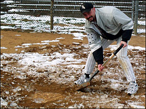Murray Reed shovels out home plate