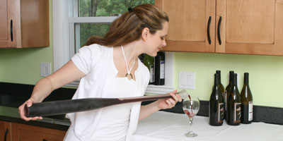 Wine Being Poured from Glass Baseball Bat