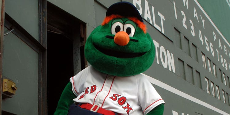 Wally the Green Monster in front of the Green Monster Wall at Fenway Park