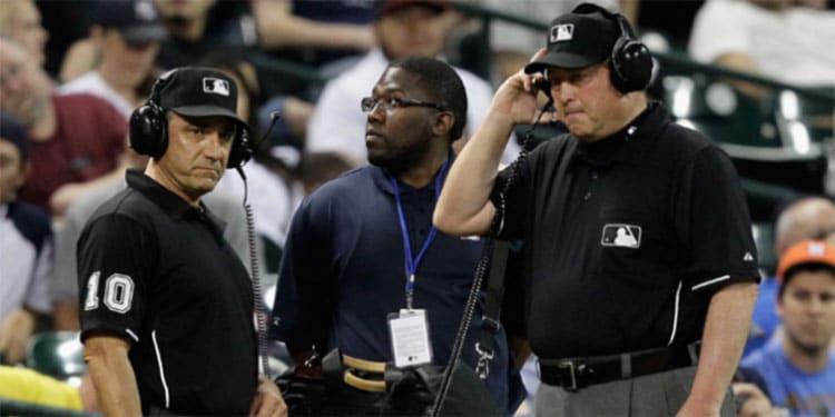 Umpires Using Instant Replay at Baseball Game