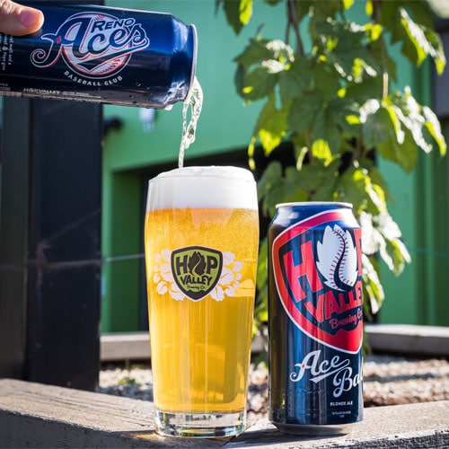 Pouring AceBall Blonde Ale from the Reno Aces