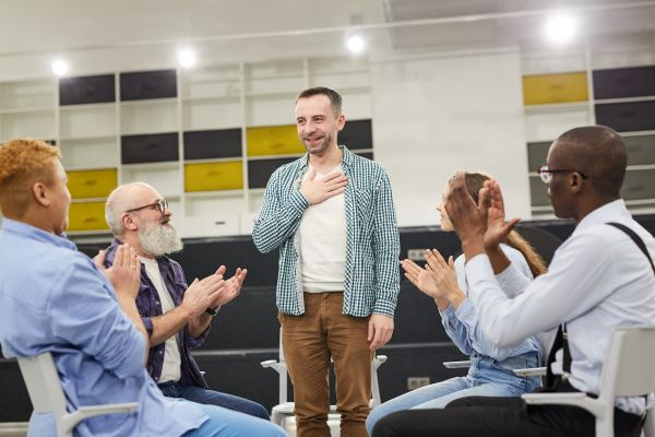 a man introducing himself to a group