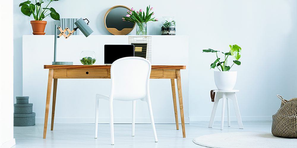 white-chair-at-wooden-desk-with-laptop-and-lamp-in-DB8S94M