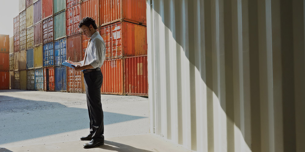 man standing inside shipping container