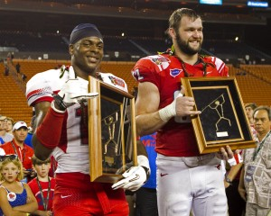 Dec 24, 2012; Southern Methodist defender Margus Hunt (92) holds his MVP trophies at the end of the Hawaii Bowl at Aloha Stadium. Credit: Marco Garcia-USA TODAY Sports