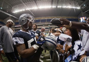 Dallas Cowboys linebacker Orie Lemon (58) signs autographs for fans during training camp at the Alamodome. Mandatory Credit: Soobum Im-USA TODAY Sports