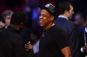 Jay-Z greet each other before the 2013 NBA all star game at the Toyota Center. Mandatory Credit: Bob Donnan-USA TODAY Sports
