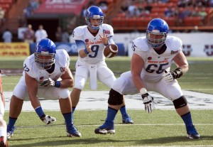 Boise State Broncos quarterback Grant Hedrick (9) takes the snap behind linemen Matt Paradis (65) and Marcus Henry (72) against the Oregon State Beavers in the 1st quarter of the 2013 Hawaii Bowl at Aloha Stadium. Mandatory Credit: Marco Garcia-USA TODAY Sports
