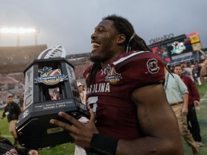 South Carolina Gamecocks defensive end Jadeveon Clowney (7) holds the Capital One Bowl trophy after defeating the Wisconsin Badgers at the game held at the Florida Citrus Bowl. Mandatory Credit: Rob Foldy-USA TODAY Sports