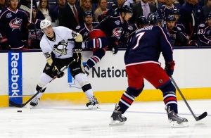 Pittsburg Penguins center Adam Payerl (45) looks to pass as Columbus Blue Jackets defenseman Jack Johnson (7) defends during the first period at Nationwide Arena. Mandatory Credit: Russell LaBounty-USA TODAY Sports