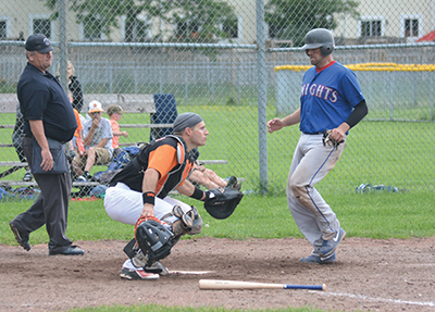 Orangeville Giants catcher, Drew Huerter, looks for the throw as a New Lowell Knights player crosses the plate during the seventh inning of Sunday's (July 16) NDBL game in Orangeville. It was a low scoring game with New Lowell getting the edge and taking a 3-1 win.