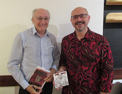 Harry Posner (left) with his recent book, and Richard Sitoski (right) with his CD. A literary and spoken word poet coming together at Pia's on Broadway in a double joint unveiling of their artwork. Posner is very active in Dufferin County, being the county's first Poet Laureate, while Sitoski has been active in the Grey County Area.