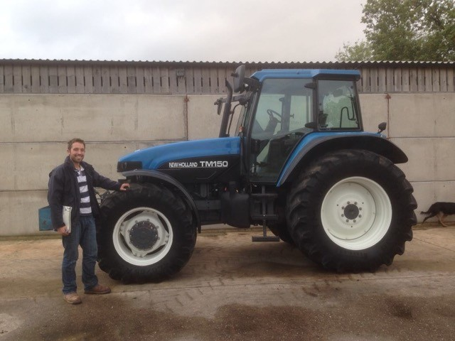 Tristan next to his Ford tractor