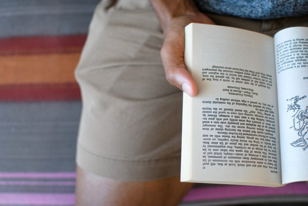 Black man reading book