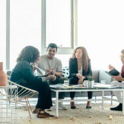 team-brainstorm-meeting-in-bright-sunny-office