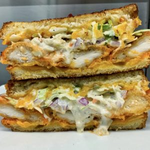 Picnic Basket Patty Melt: Buffalo fried chicken, blue cheese-celery- red onion slaw, and melting cheddar all grilled between thick slices of country cut white bread