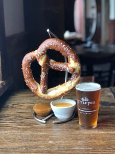 Little Pub/Big Pretzel Enormous soft baked Bavarian pretzel served with a four-cheese sauce and honey mustard dip