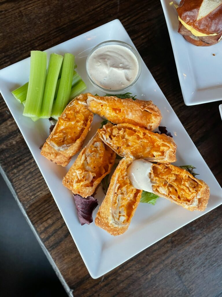 Buffalostix- Buffalo chicken eggrolls served with a bleu cheese dip
