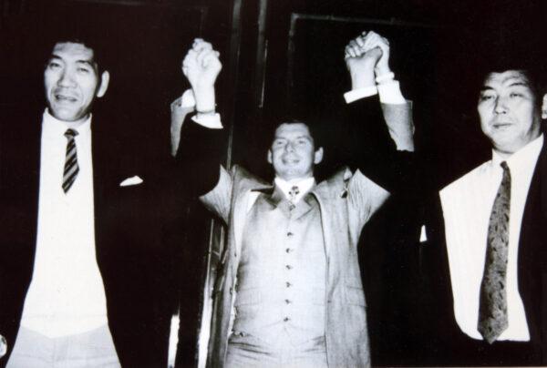 Giant Baba, Vince McMahon, and Seiki Sakaguchi pose together for a photo