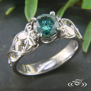 Classic Garden vine ring Green diamond center and flowers cast into place on each side of center stone, (6) bezel set round diamond (3 on each side) with hand fabricated vine work
