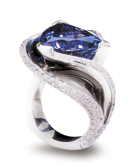 Smithsonian Institution, Washington DC - On Pernanent display at the National Museum of Natural History AGTA Spectrum Award 2001 – Platinum Guild International - Platinum Honors, Division 1 Platinum ring featuring a 12.11ct tanzanite, accented with 1.89ctw of white diamonds. This piece is available for reproduction. Contact us to find out more.