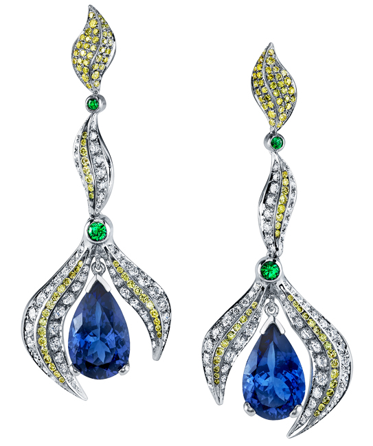 MJSA American Vision Award 2013 - 1st Place, Platinum Distinction Platinum earrings featuring two pear shaped tanzanites totaling 9.36ctw, accented with 0.28ctw of green tsavorite garnets, 0.954ctw of yellow diamonds, and 1.88ctw of white diamonds. This piece is available for reproduction. Contact us to find out more.
