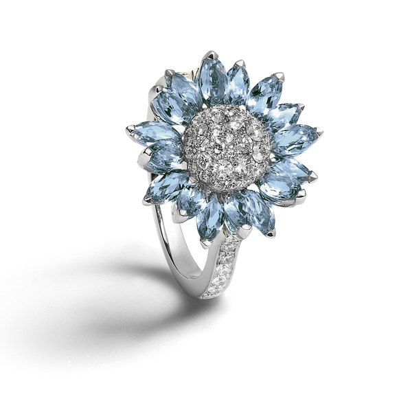 Individually set with marquise cut aquamarine petals with a pavé diamond centre, all set in 18ct white gold.