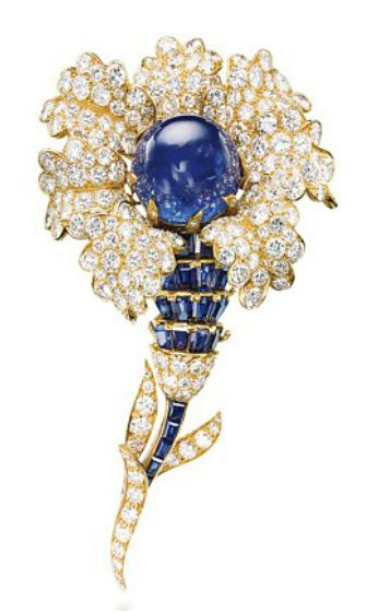 A SAPPHIRE AND DIAMOND BROOCH, BY VAN CLEEF & ARPELS. Designed as a flower, centering upon a cabochon sapphire, within pavé-set diamond petals, to the calibré-cut sapphire and brilliant-cut diamond stem, mounted in gold, 1965, 9.8 cm Signed Van Cleef & Arpels, no. N.Y. 36070