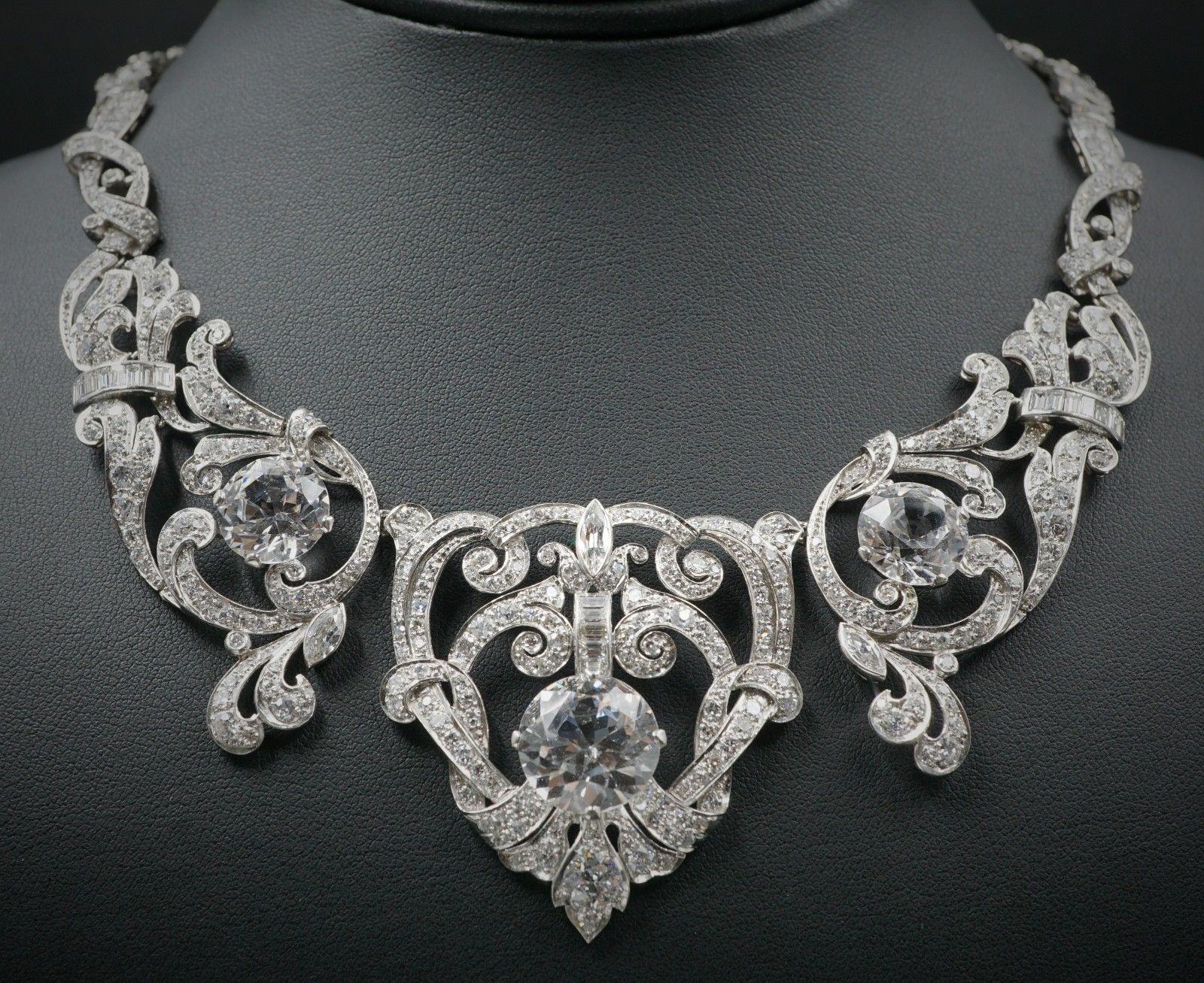 Necklace: ladies platinum Edwardian era Art Deco design open filigree natural diamond and imitation diamond link necklace, fastening with a fold-over locking clasp | 568 diamonds | 12.9 carats | Appraisal: $188,500