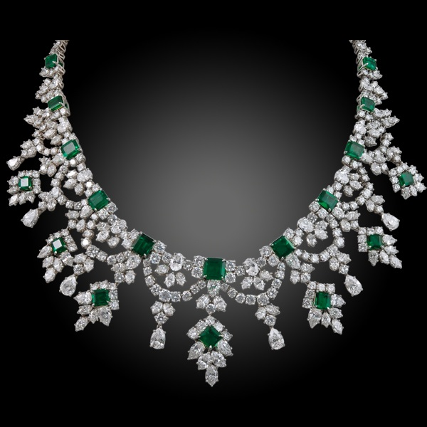 Vintage platinum diamond and Colombian emerald necklace, weighing 16 carats of diamonds and 75 carats of emerald, signed Harry Winston, circa 1970s.