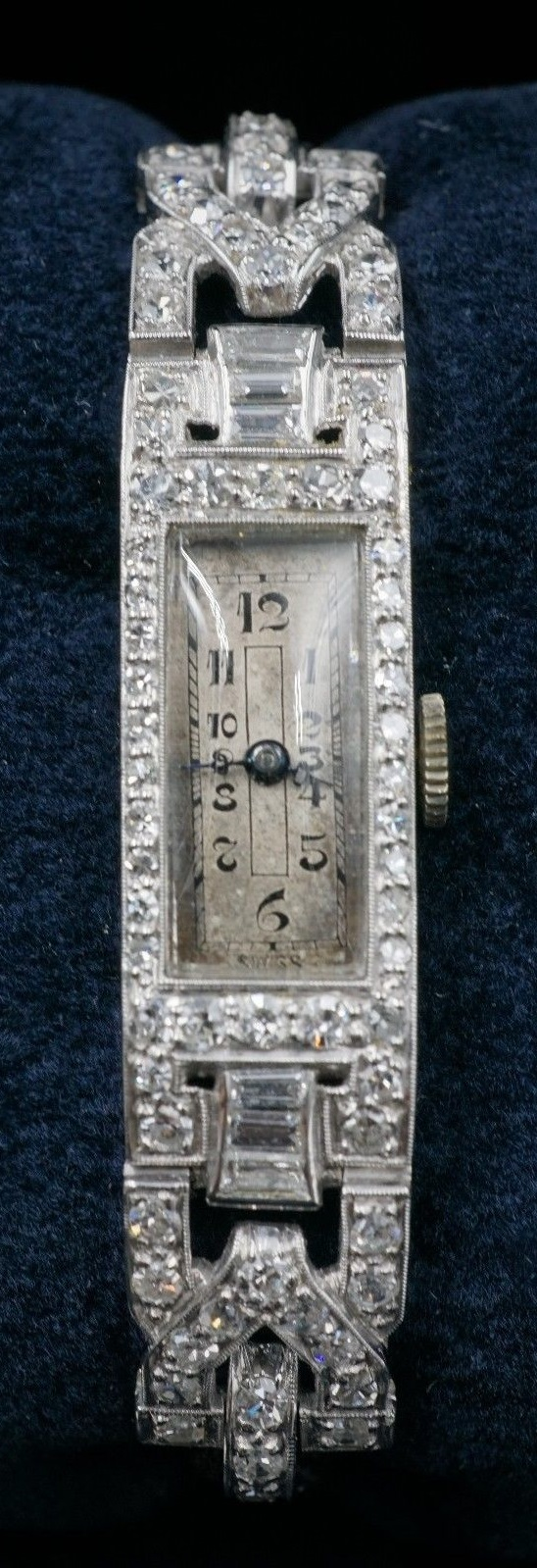 Watch: Edwardian era Rado brand 17 jewel mechanical movement watch with black cord band, fastening with a fold-over locking clasp | 68 diamonds | 1.32 carats | Appraisal: $19,950