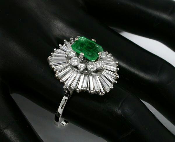 REVIEWS:  yelp reviews      prev    next  1.50ct EmeraldDiamond 14k White Gold Ballerina Ring        1.50ct Emerald Cut Emerald 2.20ct Diamond Gold Ballerina Ring 1.50ct EmeraldDiamond 14k White Gold Ballerina Ring Item: 91321PASSPrice: $2,700 Carats: 1.50 Metals: 14k gold    This is a wonderful 14 white gold ballerina ring. The ring features a ballerina design and is centered by a gorgeous emerald cut emerald that weighs approximately 1.50ct. The emerald reveals vivid green color and brilliance. This center stone is accentuated by sparkling round and baguette cut diamonds that weighs approximately 2.20ct. The color of the diamonds is H with VS clarity. The top of this ring measures 20mm by 18mm by 15mm.