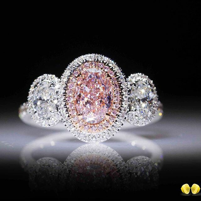 A pink diamond like no other, set in a delicate oval shaped halo with white oval cut diamonds to bring out that rare beautiful pink diamond even more!