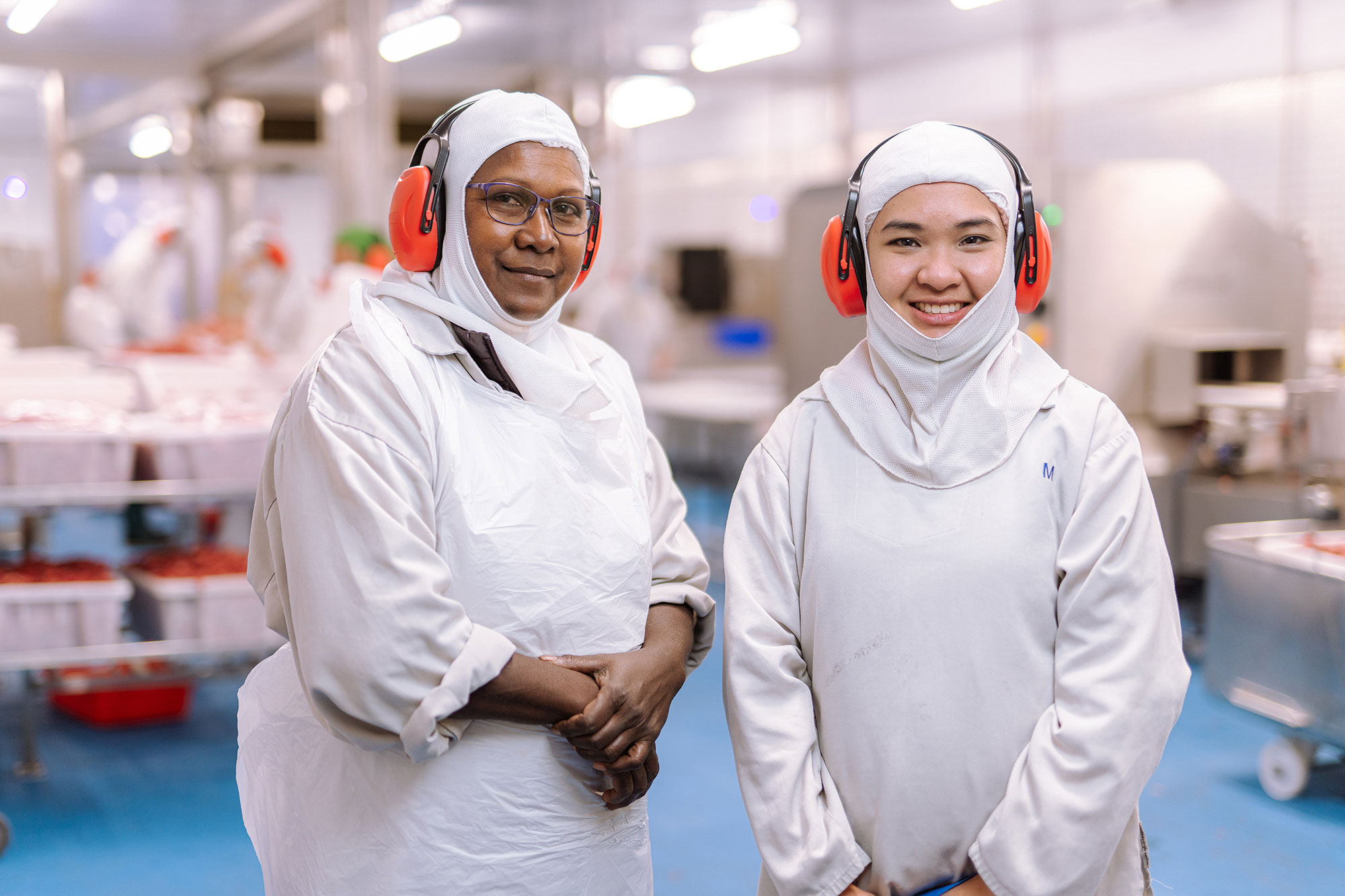 Diverse employees in factory