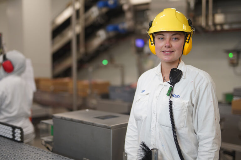 Factory worker wearing protective gear
