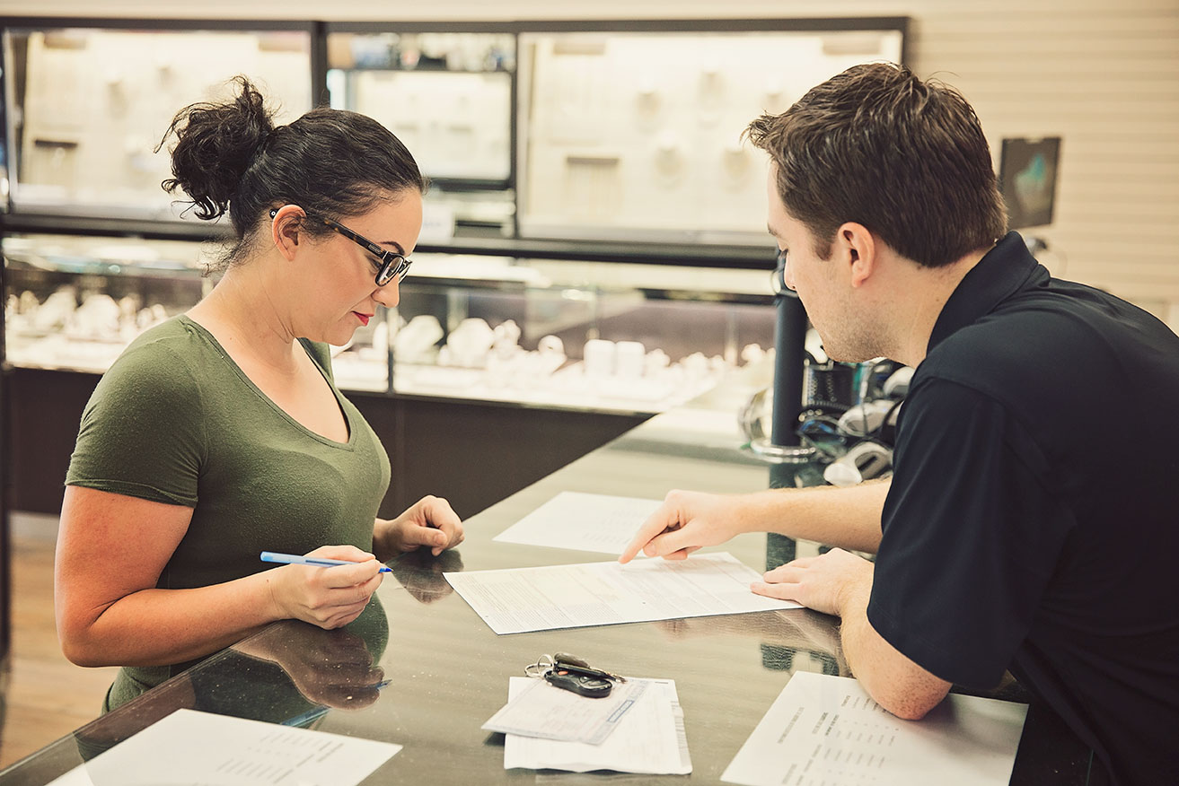 Loan-information-being-provided-by-AJ-Pawnshop-Employee