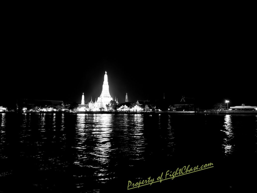 Wat Arun at night from across the river. Bangkok Thailand