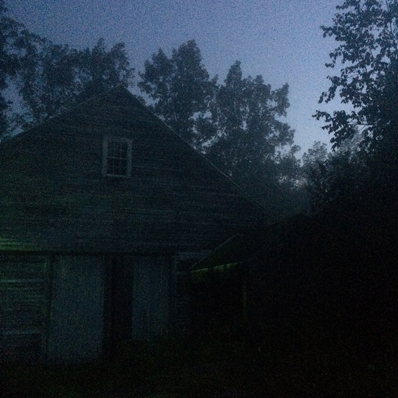 Barn on a misty evening - copyright John Bennett