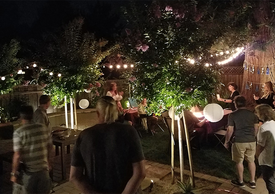 Outdoor party scene at night with low voltage lighting illuminating area