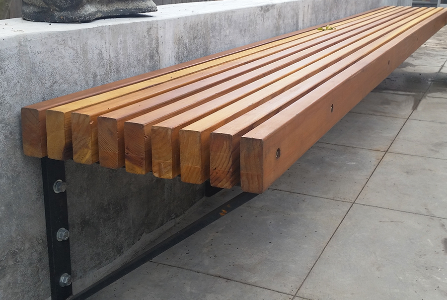 Close-up view of a slatted wooden bench
