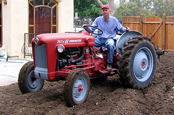 Greg Gatwood on a tractor tilling soil